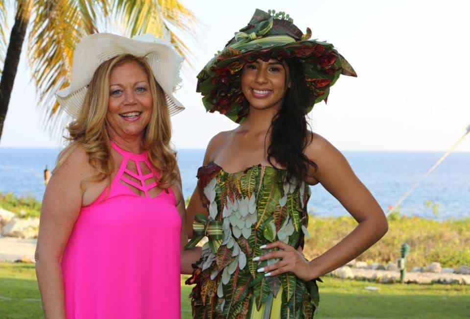 Miss Cayman Islands models a dress & hat by Celebrations made entirely out of fresh local greenery