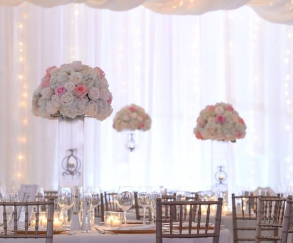 TWINKLING WEDDING WITH FLOOR-TO-CEILING DRAPING
