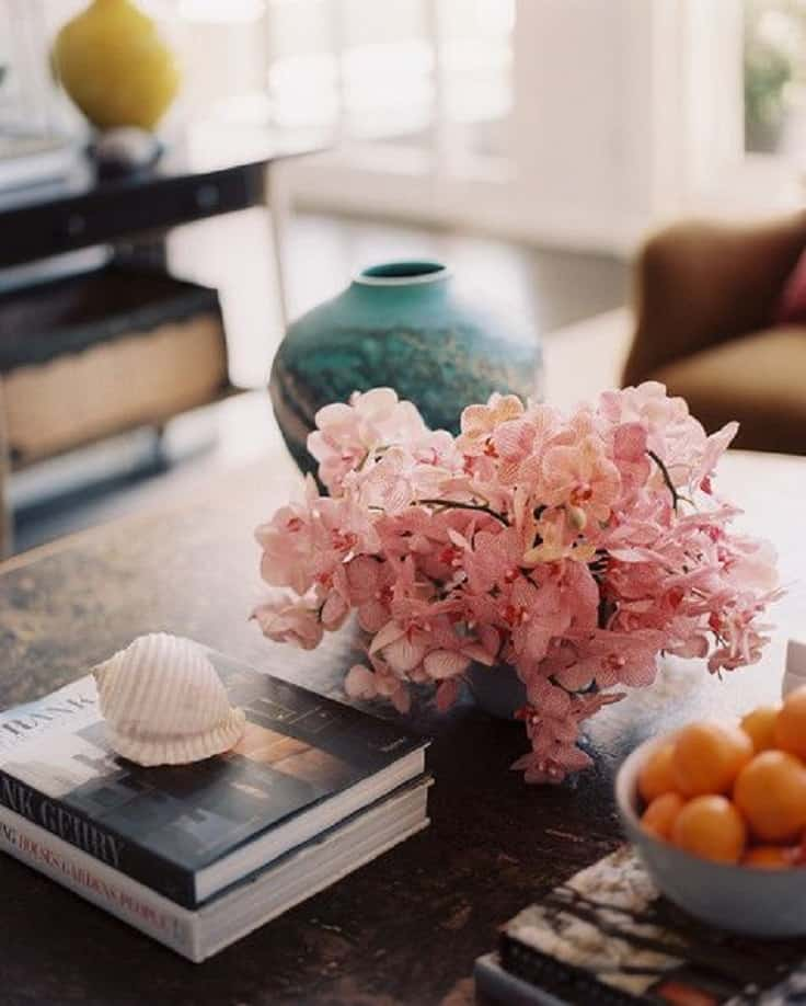 Rustic Coffee Table Decorated With Books And Natural