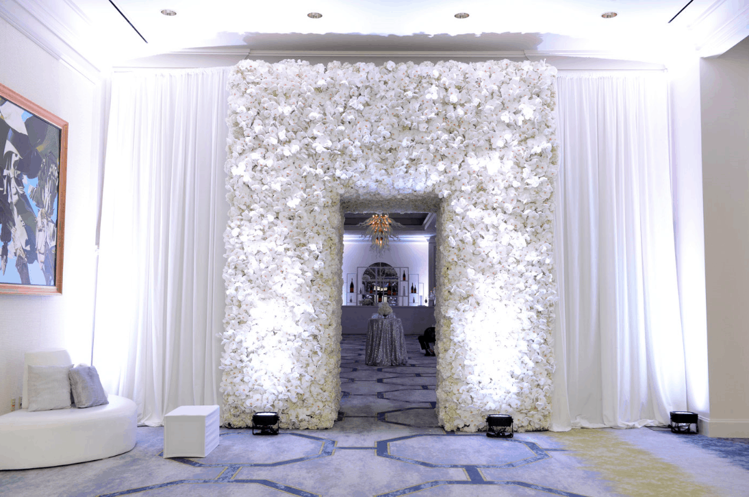Destination wedding photo wall made of Phalaenopsis Orchids - we created this for the set up Karen Tran visited our islands