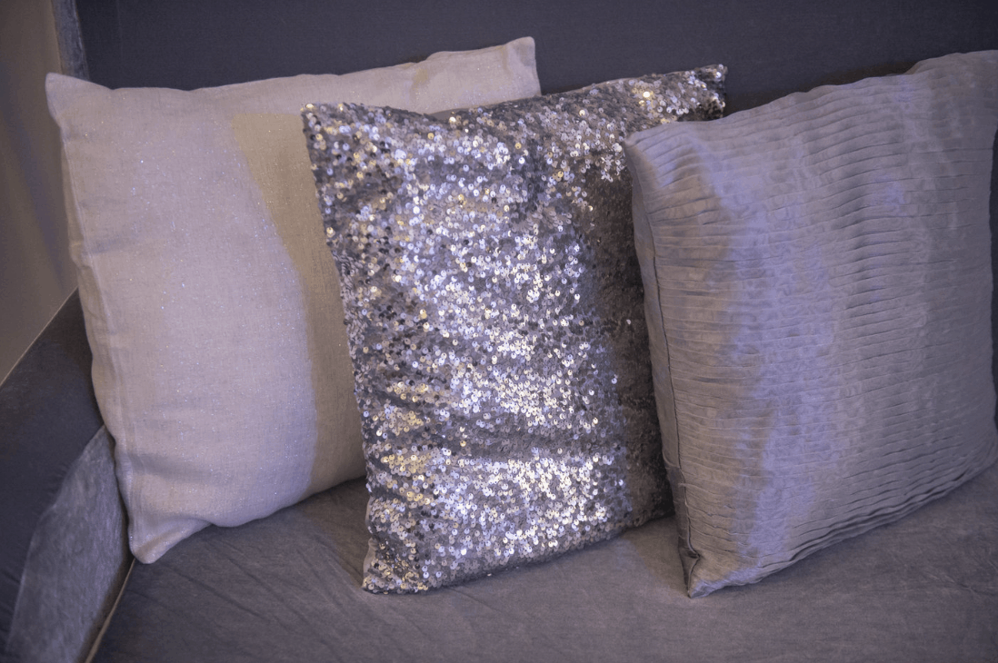 destination wedding lounge details - decorative pillows of textures and sequins
