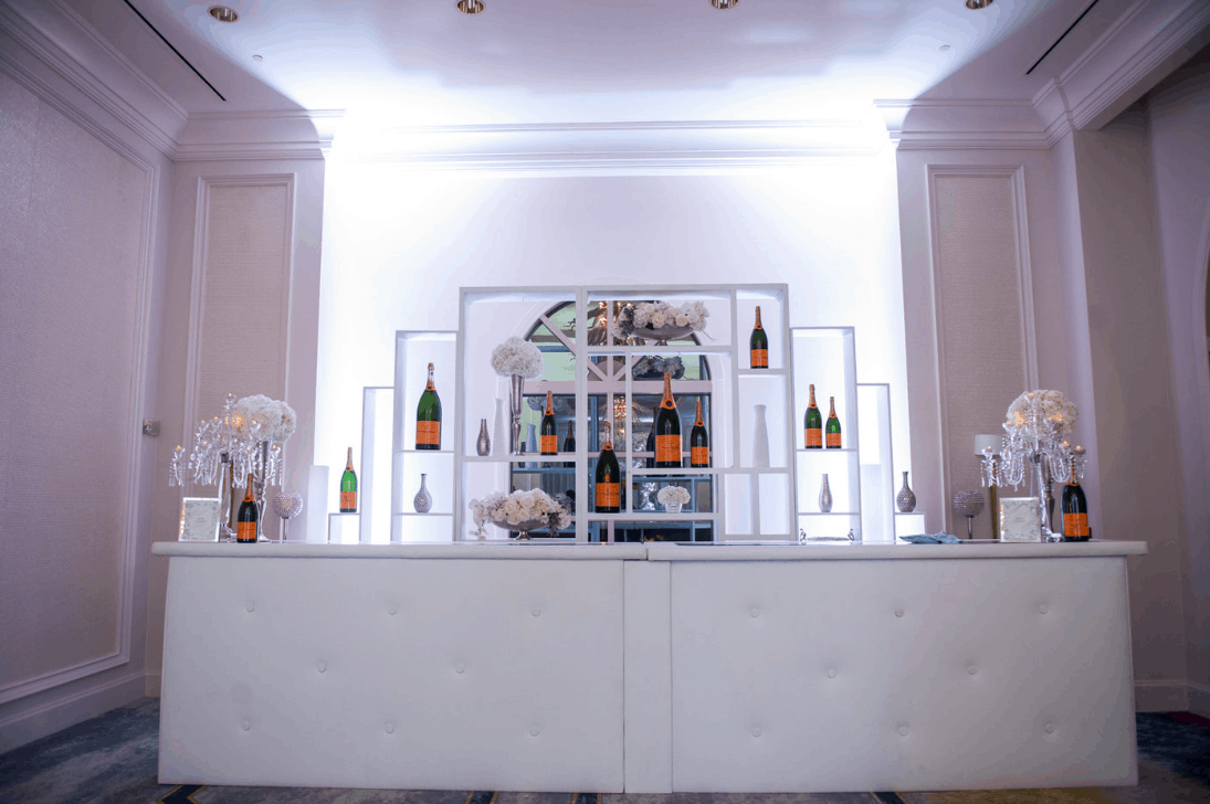 veuve cliquot wedding bar - white leather lounge bar - chic sophistication