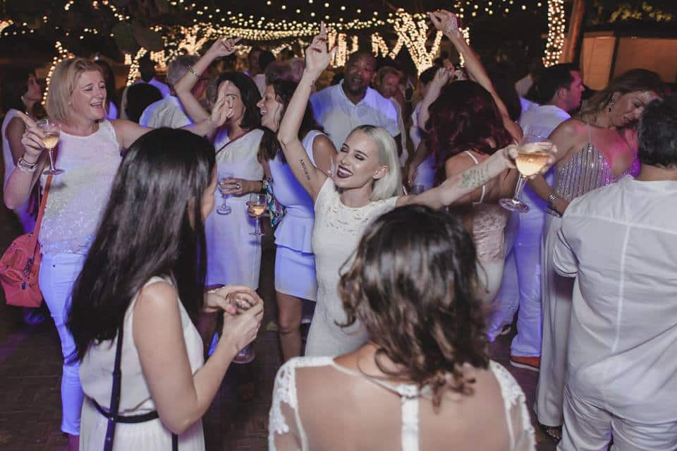 Guests dancing under the starry night at the Dinner in White