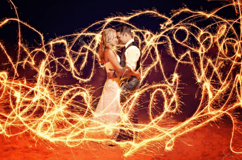 wedding sparklers on the beach - beautiful photo from Celebrations Ltd. wedding in the Cayman Islands