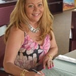 author jo anne v. brown signing her book, caribbean wedding style