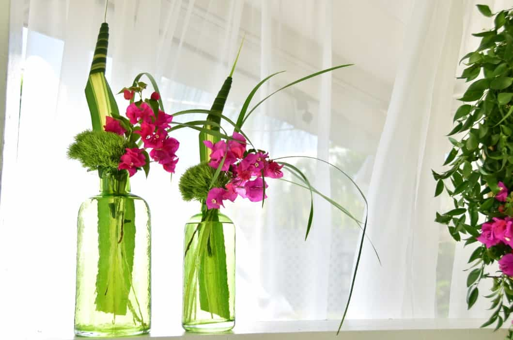 chic girly floral arrangement using vintage jars - beautiful and tripical