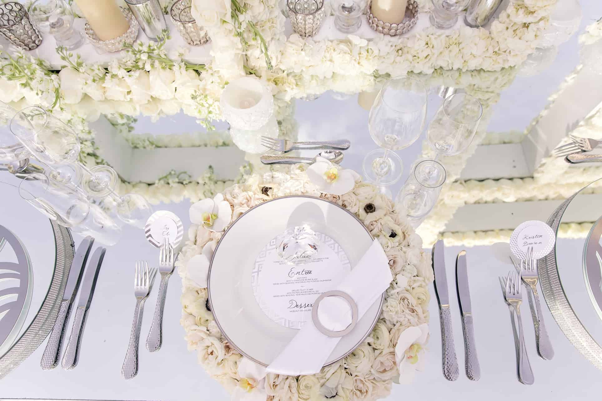 silver white luxurious wedding table place settings celebrations ltd cayman islands destination wedding