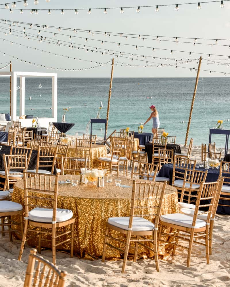 Black and gold decor for corporate beach event, Celebrations Cayman Wedding and Event Planners