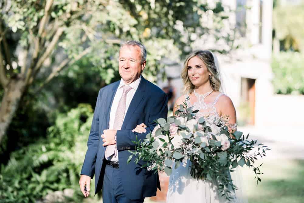 Walking down the aisle elegant bohemian wedding in Grand Cayman