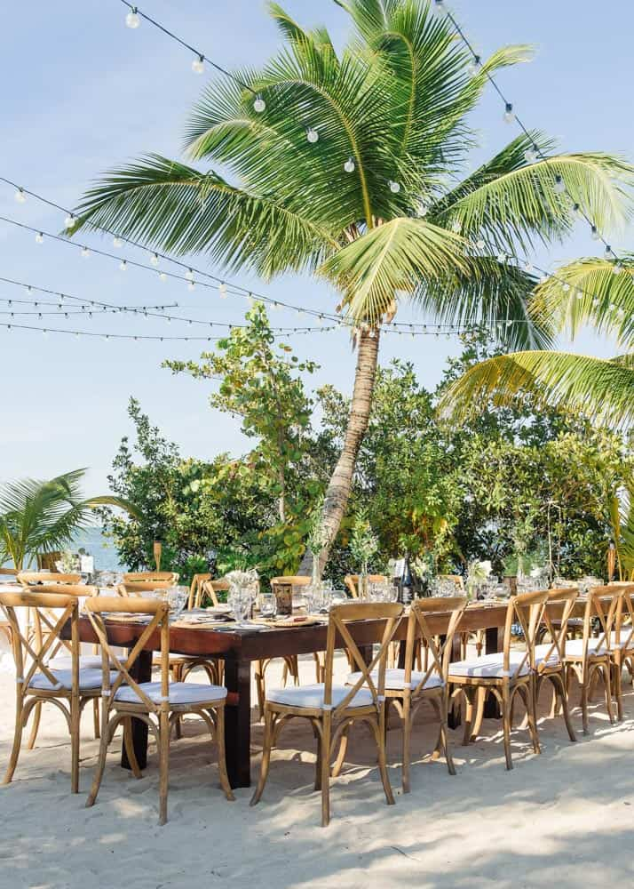 Outdoor reception for elegant bohemian wedding on the beach in Grand Cayman