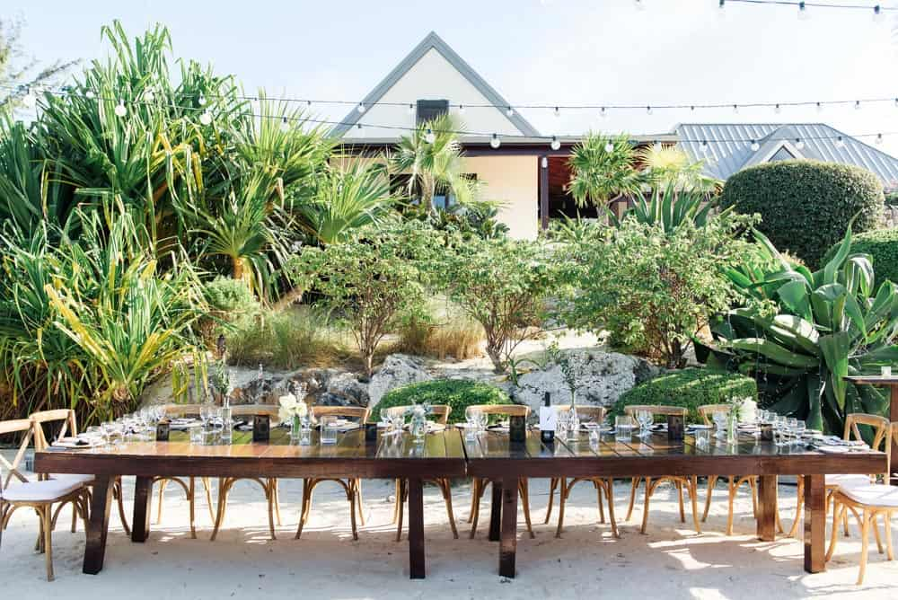 Head table for an elegant botanical bohemian wedding in Grand Cayman