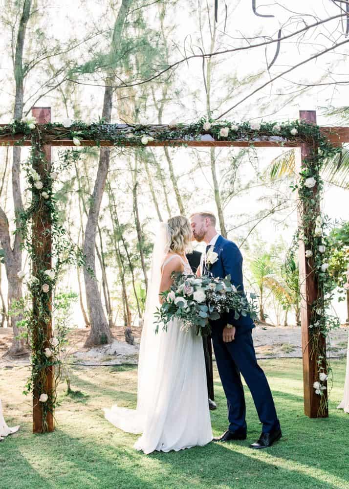 Elegant bohemian wedding ceremony arch for Grand Cayman wedding by Celebrations Cayman Islands Wedding Planners