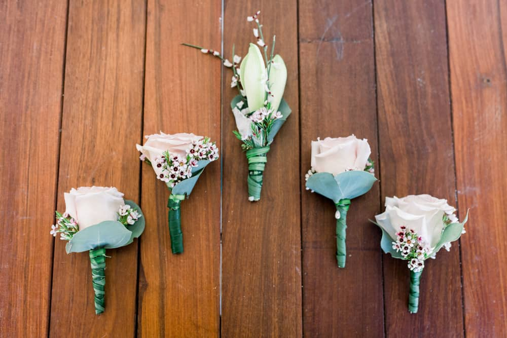 Rustic bohemian boutonnieres for a Grand Cayman wedding by Celebrations Wedding Planners, Designs, Producers and Florists