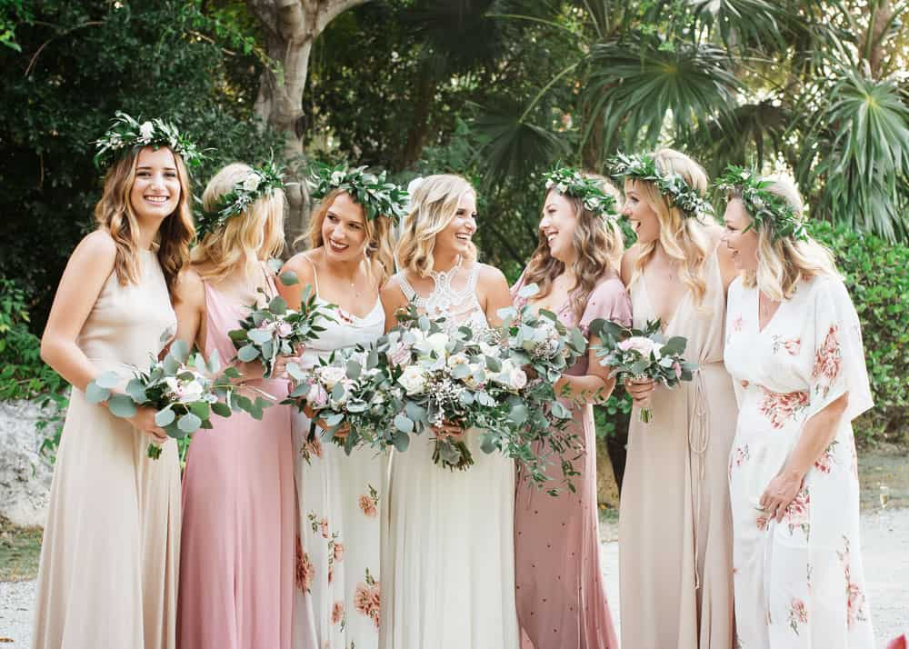 Blush dresses and stunning bouquets for this elegant bohemian wedding in Grand Cayman by Celebrations wedding planners