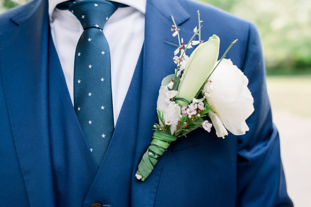 Elegant bohemian boutonniere for the groom for a Grand Cayman Wedding by Celebrations Wedding Planners