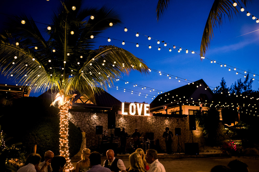 Lit love sign with string lights at wedding in Cayman Islands